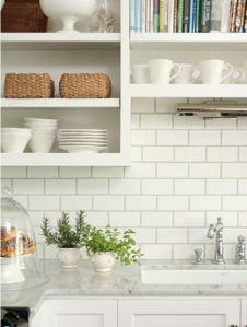 kitchen close up backsplash white subway tiles dark grey grout open shelving shelves marble countertops white cabinets